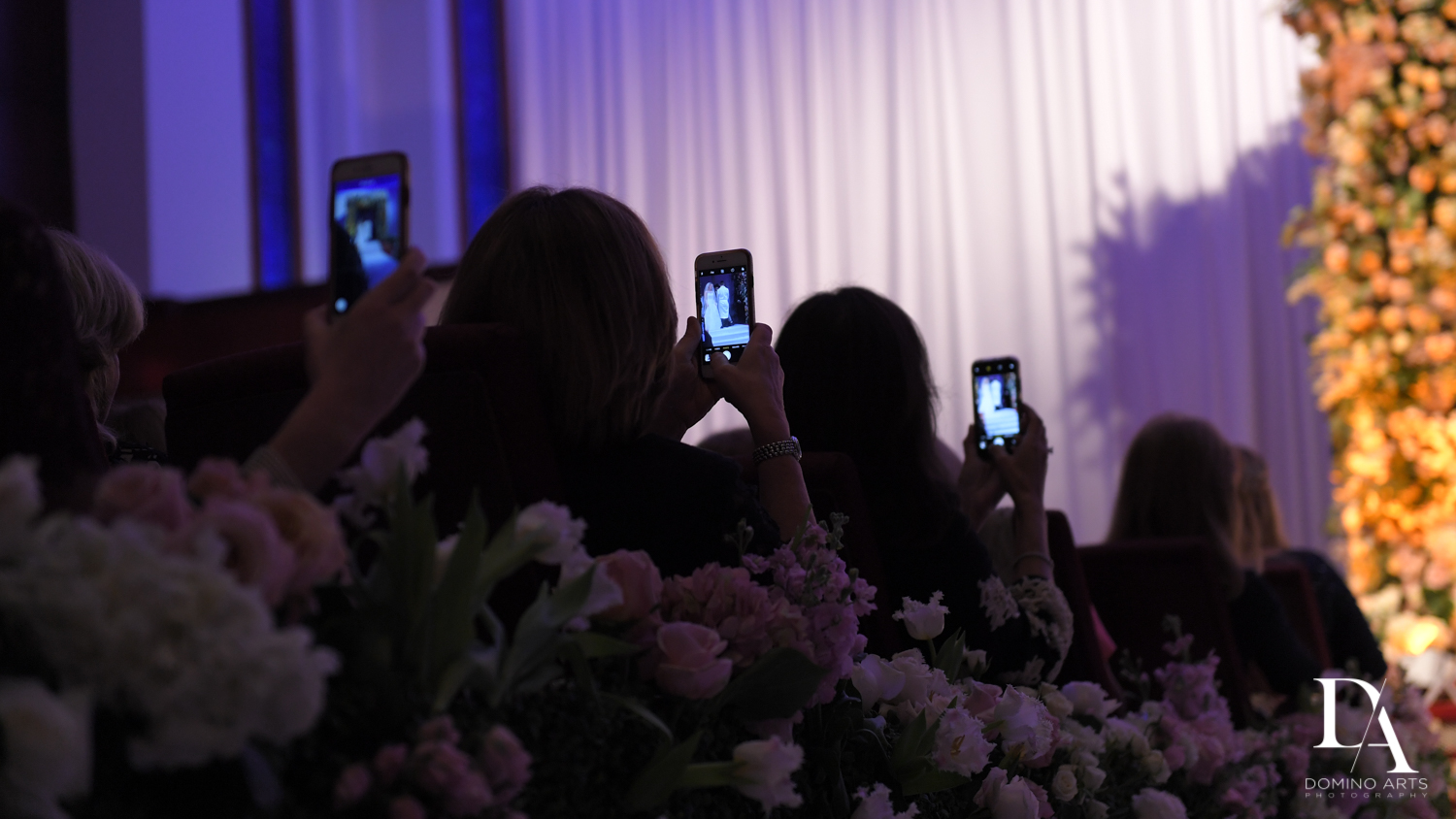 mobile phones at wedding by domino arts