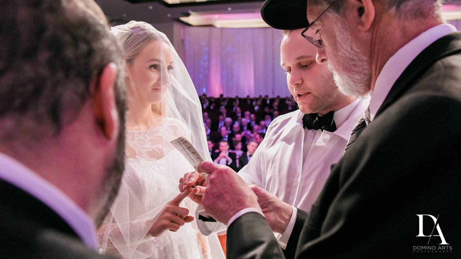 jewish ring exchange at Lavish Flowers & Crystals Wedding at Aventura Turnberry Jewish Center by Domino Arts Photography