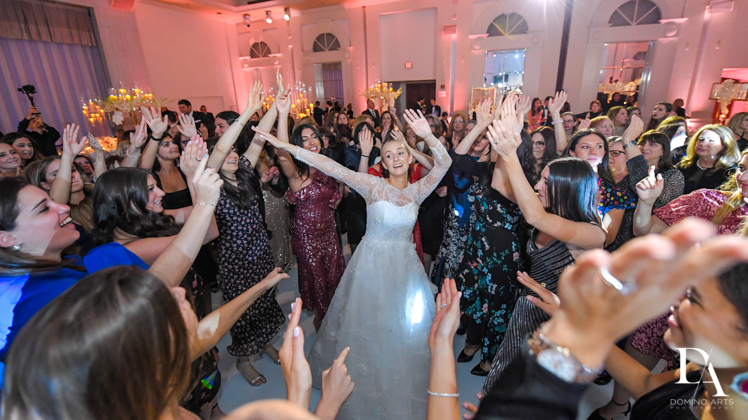 dancing bride at Lavish Flowers & Crystals Wedding at Aventura Turnberry Jewish Center by Domino Arts Photography