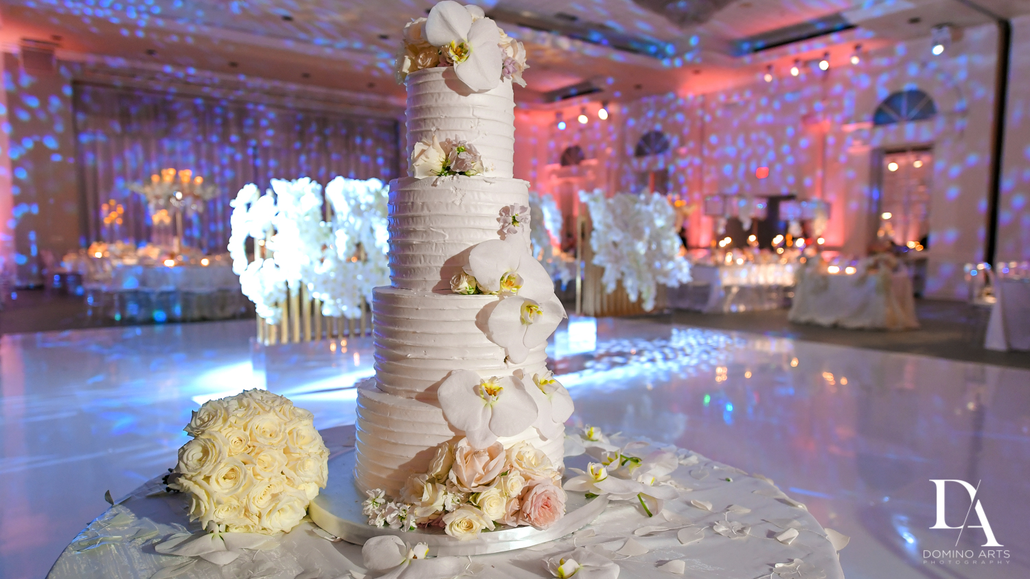 white wedding cake at Lavish Flowers & Crystals Wedding at Aventura Turnberry Jewish Center by Domino Arts Photography