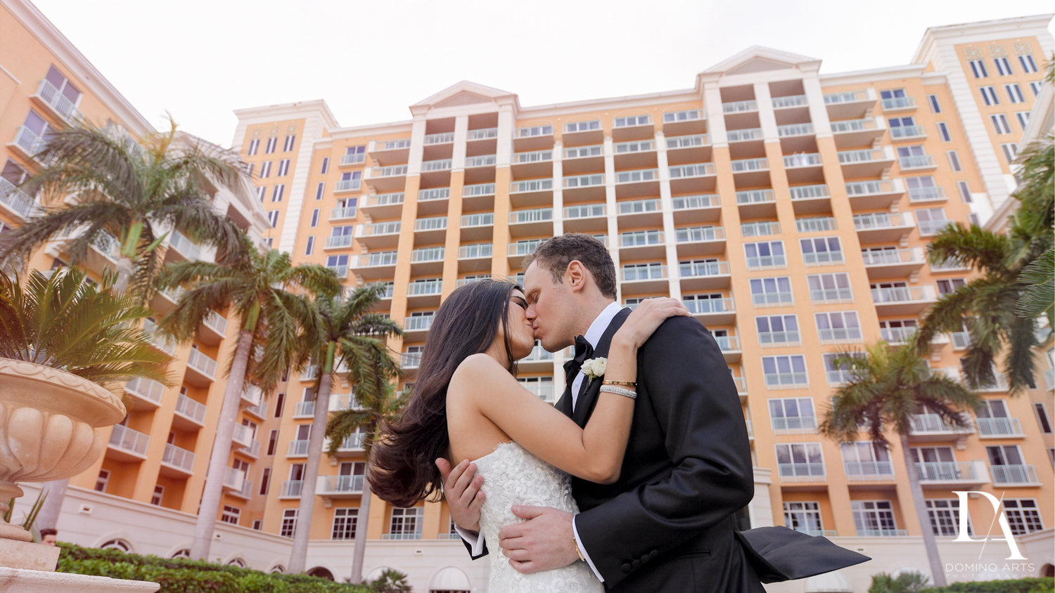 wedding kiss at A Ritz Carlton Wedding in Key Biscayne by Domino Arts Photography