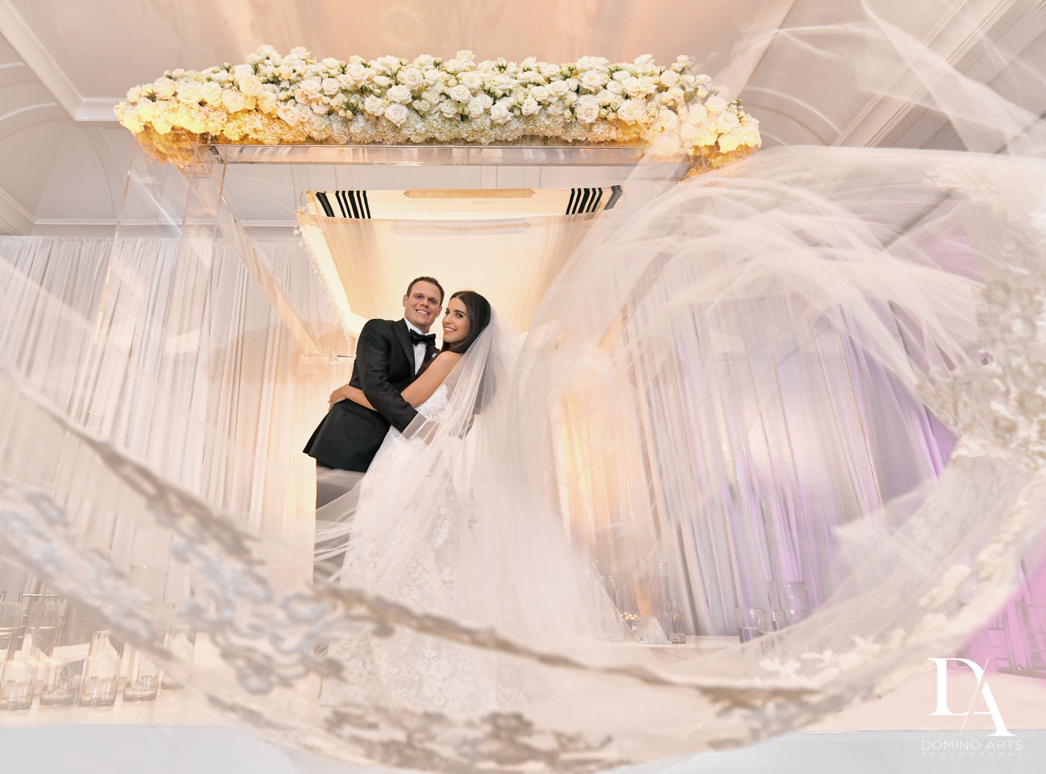 floral chuppah at A Ritz Carlton Wedding in Key Biscayne by Domino Arts Photography