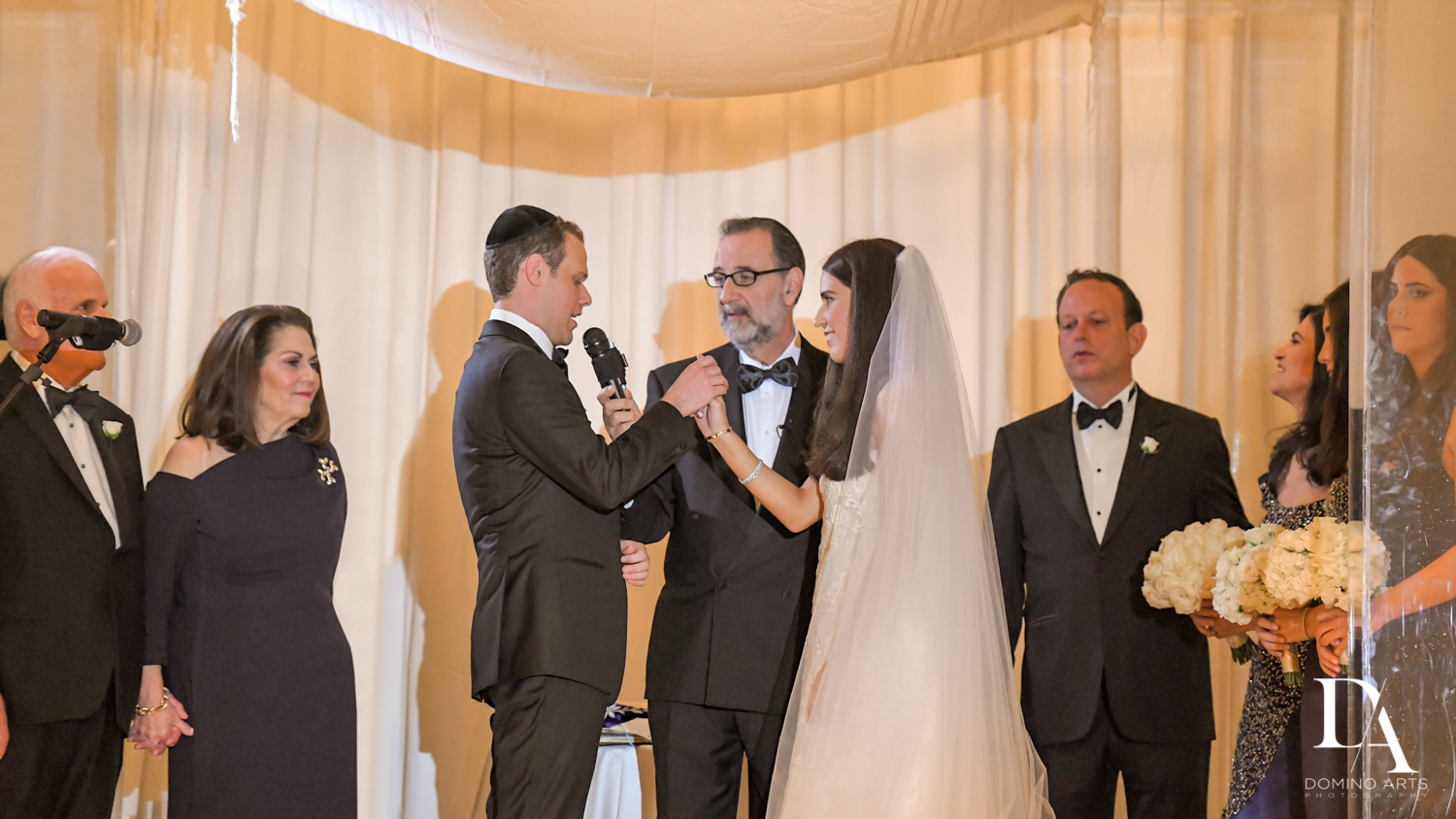 ring ceremony at A Ritz Carlton Wedding in Key Biscayne by Domino Arts Photography