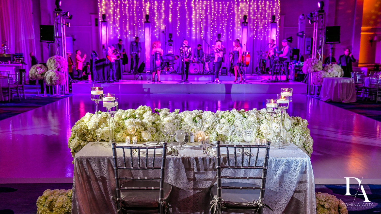white flowers purple room at A Ritz Carlton Wedding in Key Biscayne by Domino Arts Photography