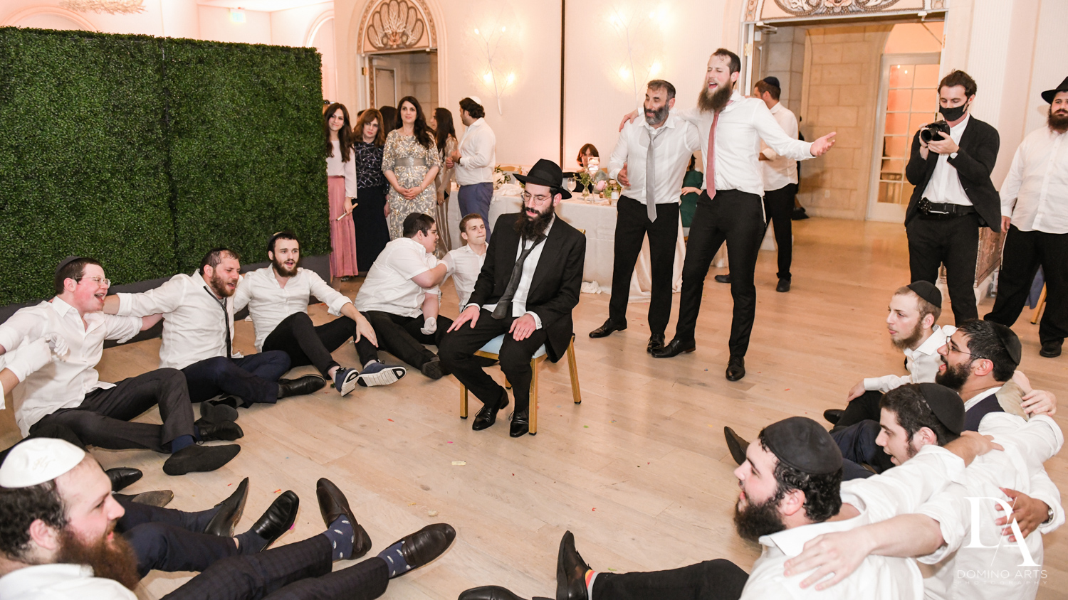 groomsmen dance at Jewish Orthodox Wedding in Palm Beach by Domino Arts Photography