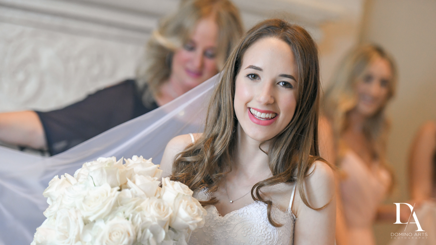 happy bride with bouquet at Beautiful Intimate Wedding at Mizner Country Club by Domino Arts Photography