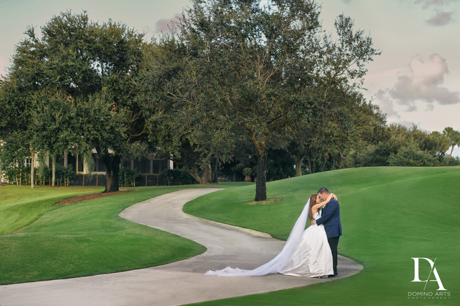 bride and groom on golf course at Beautiful Intimate Wedding at Mizner Country Club by Domino Arts Photography