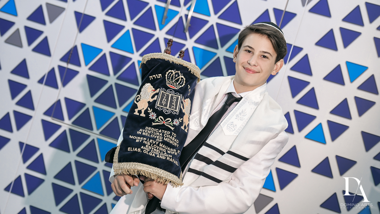 Boy with Torah at Monochrome Bar Mitzvah Ceremony at Aventura Chabad by Domino Arts Photography