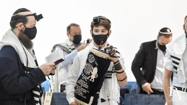 Carrying Torah at Bar Mitzvah Ceremony at Aventura Chabad by Domino Arts Photography