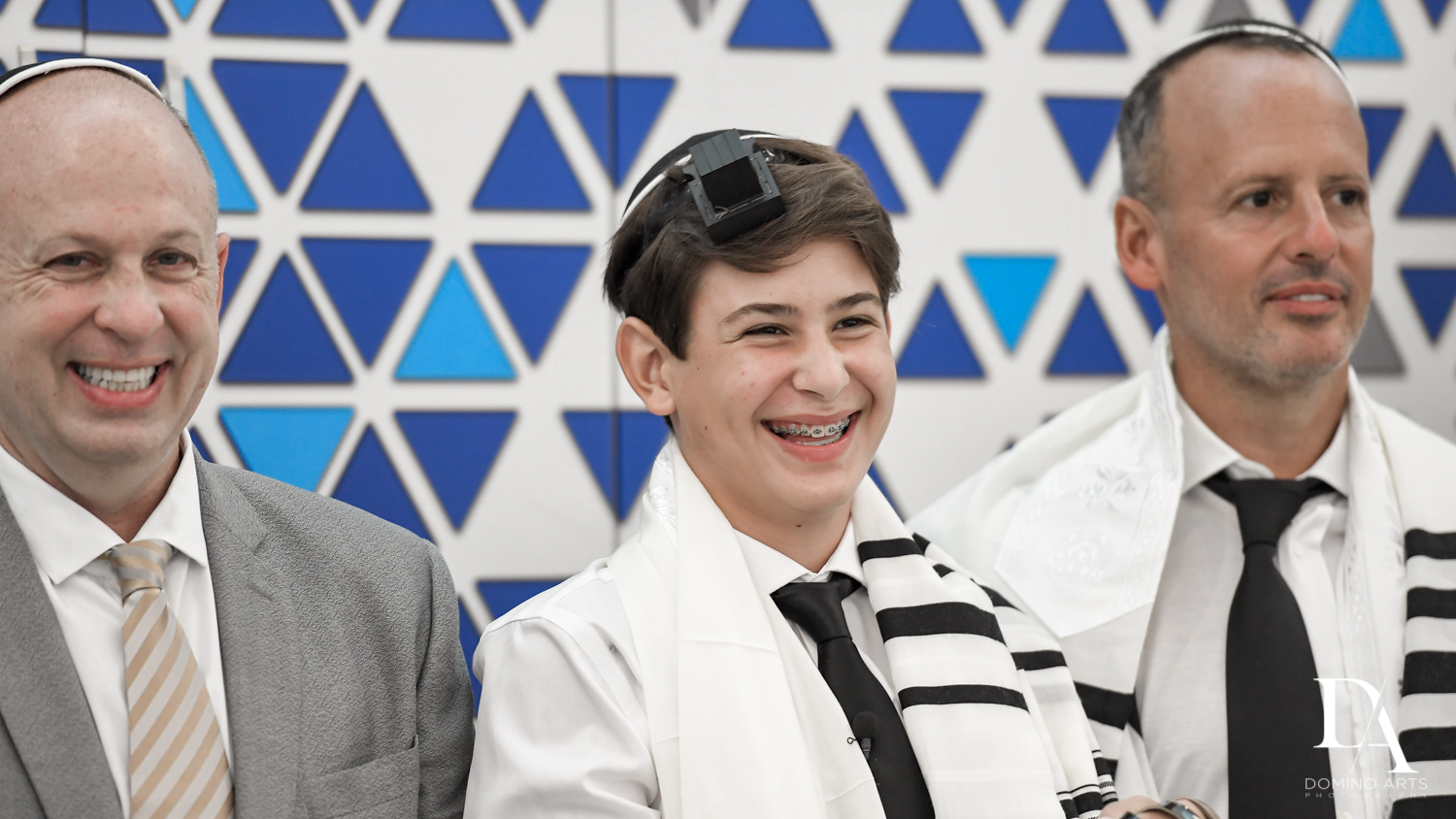 happy boy at Monochrome Bar Mitzvah Ceremony at Aventura Chabad by Domino Arts Photography